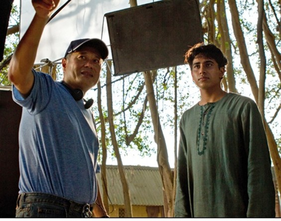 Director Ang Lee confers with Suraj Sharma on the set. - JAKE NETTER