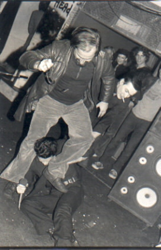 Dirk Dirksen, seen here stomping the shit out of Frankie Fix of the band CRIME, is now the official namesake of 'Dirk Dirksen Place' in North Beach - JAMES STARK