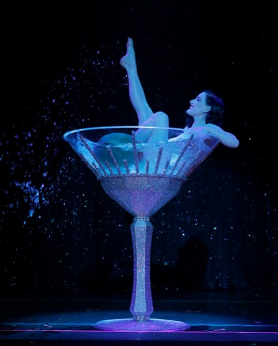 Dita shows off her signature martini glass act in Strip Strip Hooray!