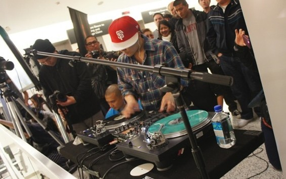 DJ Qbert performing at SFO's Terminal 2. - COURTESY SFO MUSEUM