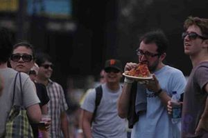 Dude harfing pizza at last year's fest. - DOUG ZIMMERMAN