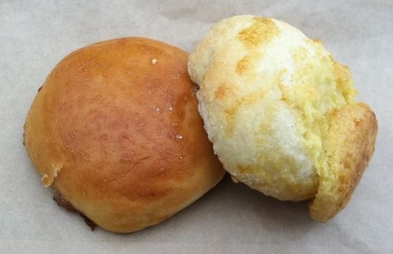 Dumplings & Bun's pork bun (l.) and vanilla custard bun, each $2. - JONATHAN KAUFFMAN