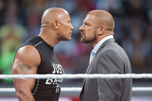 "East Bay boy Dwayne ""The Rock"" Johnson (HAYWARD, represent), squaring off with Triple H (an abbreviation of the character's full name, Hunter Hearst Helmsley). - DON FERIA/AP IMAGES FOR WWE"