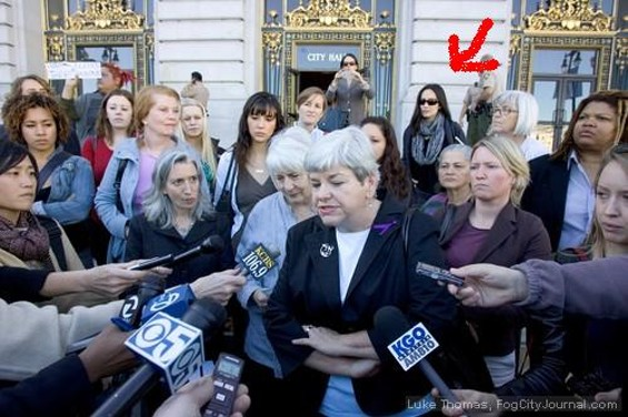 Eliana Lopez, Ross Mirkarimi's wife, stands with domestic violence activists calling for her husband to resign due to allegations he domestically abused her - LUKE THOMAS, FOG CITY JOURNAL