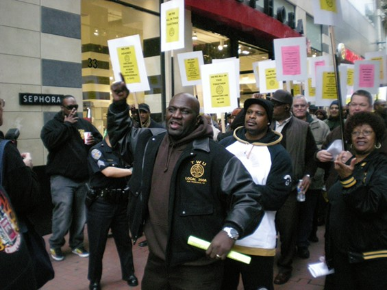 Eric Williams, center, may be a whiz at leading an effective march. But his ability to expound upon Muni's budget is questionable. - FROM MTA BUDGET