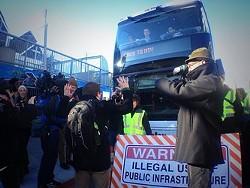 Protesters block a tech bus. - JOE FITZGERALD RODRIGUEZ