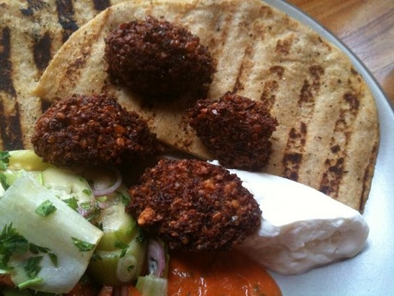 Falafel with spicy cucumbers, yogurt, and grilled pita, $11, on Zut!'s lunch and brunch menus. - JOHN BIRDSALL