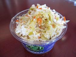 JONATHAN KAUFFMAN - Farmhouse Culture's horseradish-leek-sauerkraut at Ferry Plaza comes with a shot of kraut juice.