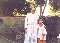 JOHN DOE 129 - Father Donald McGuire and John Doe 129 at the boy's first communion in 1982.