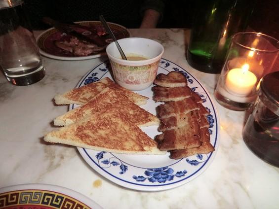 Fatty Cue's coriander-marinated bacon with yellow curry custard. - ALEX HOCHMAN