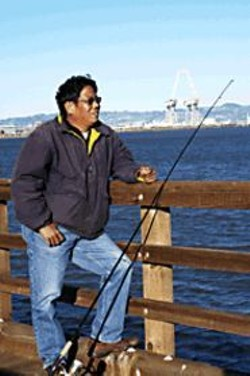 JAMES  SANDERS - Fernando Banaria waits for a bite at Candlestick Point.