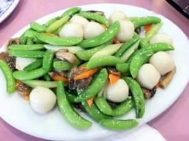 Fish balls with snap peas. - JONATHAN KAUFFMAN