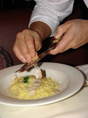Fit for a pig: White truffles shaved over Poggio's house-made tajarin pasta. - POGGIO