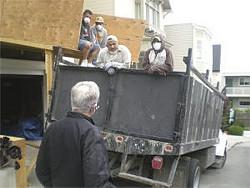 Former SPOT director Pat Tobin confronts roofers blocking a sidewalk - JOE ESKENAZI