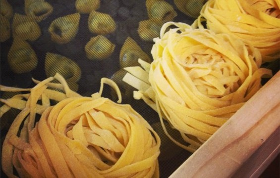 Fresh Mattarello tagliatelle resting on a specially made rack. - ANNA ROTH