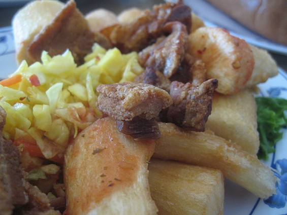 Fried yuca with chicharron. - RON DIGGITY/FLICKR