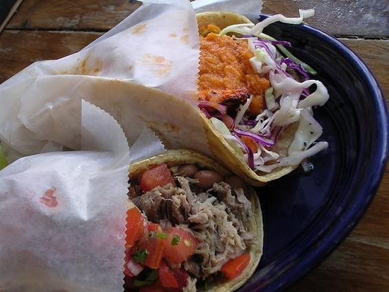 From top to bottom: Veracruz pescado taco ($5.75), carnitas taco ($4.75). - JOHN BIRDSALL