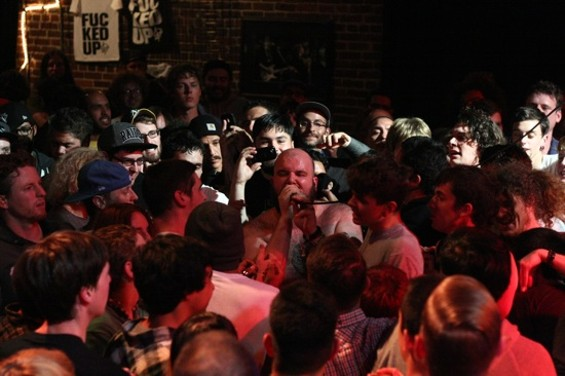 Fucked Up frontman Damian Abraham mixing it up with the crowd at Slim's last night. - MATT GILL