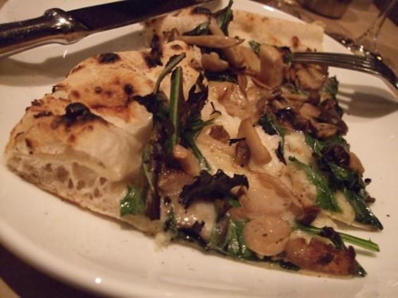 Funghi pizza with smoked mozzarella, grana, garlic, oregano, dandelion greens, and olive oil ($17.50). - TAMARA PALMER