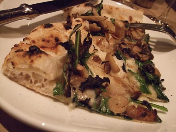 Funghi pizza with smoked mozzarella, grana, garlic, oregano, dandelion greens, and olive oil ($17.50). - TAMARA PALMER