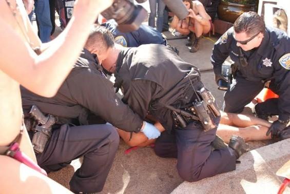 Gameli Anumu's arrest at Castro Nude-in in February. - INTI GONZALEZ