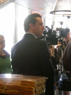 Gavin Newsom, hot dog buns, face the press - JOE ESKENAZI