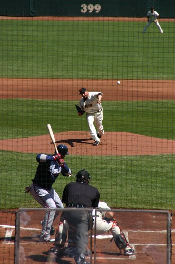 Giants starter Jonathan Sanchez blows this one past Braves shortstop Yunel Escobar en route to a strikeout