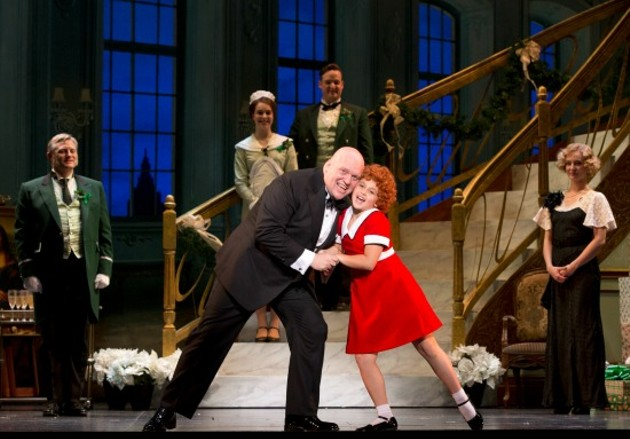Gilgamesh Taggett as Oliver Warbucks and Issie Swickle as Annie - JOAN MARCUS