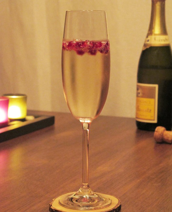 Glass of Cremant d'Alsace with pomegranate seeds - LOU BUSTAMANTE