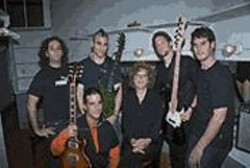 """BILLY  DOUGLAS - """"Godmother of Rock"""" and force behind Nadine's Wild - Weekend, Nadine Condon kicks it backstage at - Bimbo's with the boys of Echobrain. The event - showcases more than 100 bands from Northern - California on August 22-24."""