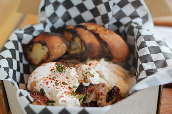 Grégoire does breakfast up right: duck confit hash and poached eggs - MOLLY GORE