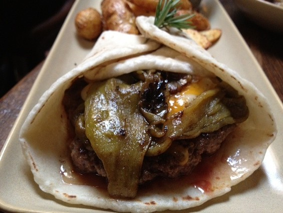 Green chile cheeseburger, served in a flour tortilla. - TAMARA PALMER