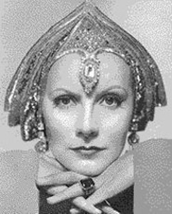 Greta Garbo works the deco headgear.