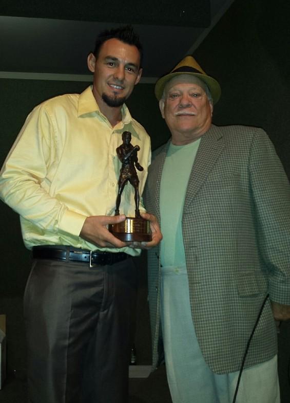 Guerrero accepts his rather unique trophy from NCBA President Joe Amato - NCBA