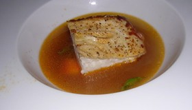 Halibut in smoky seafood broth at a Saison prix fixe from July. - J. BIRDSALL