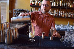 THE ALEMBIC - Head bartender Larry Piaskowy pours the silky smooth Mr. Kipling's Flip, meant to go with a Trefoil or two.