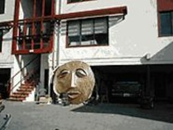 BOB  FISHER - Here Comes the Sun: The entrance to the original - lending library at Baker Beach Apartments.