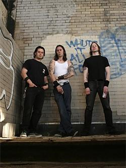 TAIJA HORN - High on Fire, from left to right: Des Kensel, Matt Pike, Jeff Matz