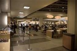 "JAMES  SANDERS - Holding Court: The basement-level ""Restaurant Emporium"" at Westfield."