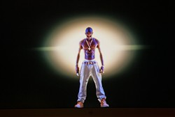 AP PHOTO/DAMIAN DOVARGANES - Hologram Tupac: We're pretty sure the real one would be pissed.