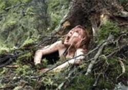ALEX  BAILEY - Hot Dirty Girls: Sarah (Shauna Macdonald) catches a breath of fresh air.