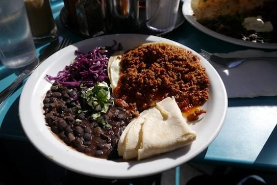 Huevos ranchero with chorizo, black beans and tortillas