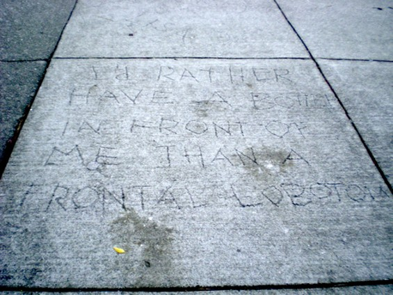 'I'd rather have a bottle in front of me than a frontal lobotomy' reads the pavement. - JOE ESKENAZI