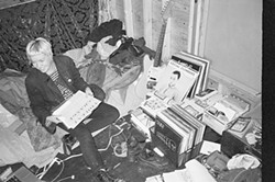 Image from a series of black and white photographs of record collectors and enthusiasts in their homes.
