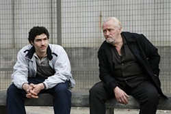 In jail, Malik (Tahar Rahim) learns the underworld ropes from César (Niels Arestrup).