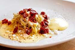 ANNA LATINO - In the chitarra bachata, plaintain noodles, chorizo, and egg sauce create a Latin American carbonara.