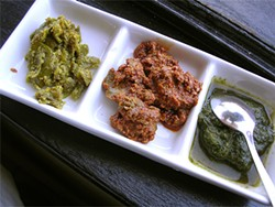 JOHN BIRDSALL - Indian pickles at Green Coriander; the right-hand compartment holds house-made green chutney.