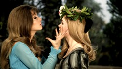 Ingrid Pitt (left) seducing an unknown young lady in The Vampire Lovers (1970) - HAMMER FILMS