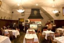 JAMES  SANDERS - Inside & Out: The cozy Antica Trattoria drew us in.