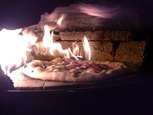 """Inside Pizzahacker's 1000-degree """"Franken-Weber"""" oven. - T. PALMER"""